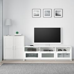 BRIMNES TV storage combination, white, 101 When it's organized by the TV it's easier to indulge in your favorite TV series. Keep your games, controls and accessories in the large drawers and feed the cords through the outlets in the back. Brimnes, Living Room Tv, Apartment Living, Ikea Tv, Tv Bench, Tv Accessories, Painted Drawers, Glass Cabinet Doors, Glass Shelves