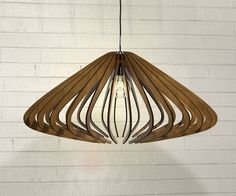 wood Pendant Light lasercut Chandelier lamp Handmade plywood hanging ceiling cup ecological minimal modern design industrial by AAarchiTECtureLab on Etsy https://www.etsy.com/listing/264200018/wood-pendant-light-lasercut-chandelier