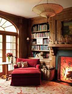 Love the Fortuny light fixture: This sumptuous library boasts a commitment to sustainable and eco-kind materials from the ground up. - Traditional Home ® / Photo: Joe Schmelzer / Design: Timothy Corrigan