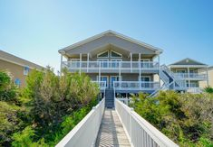 WeeBee Down - Four Bedroom Home is located in the Surfside Beach district of Myrtle Beach, 6 miles from Myrtle Beach State Park, 7 miles from The Market. Myrtle Beach State Park, Myrtle Beach Boardwalk, Surfside Beach, Bath Or Shower, State Parks, Flat Screen, Hotels, Stairs, Vacation