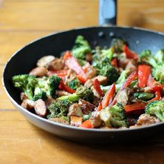 Sesame Chicken Stir-Fry served with a sweet Coconut-Ginger Brown Rice - topped with crushed cashews. And it's healthy!