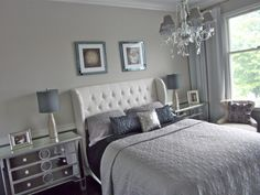 calm silver guest bedroom, Thank you, the pillows where from target, E bay, the bedding TJ Max,  the headboard at CSN store on line, the night stands I bought at daffys, the lamps are from Home Goods, The paint is Benjamin Moore, bottom wall is 1600 timber wolf, top wall is HC-169 conventry gray and the chandelier is from online store the gallerie. Thanks, Bedrooms Design