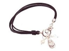 brown leather & sterling silver kiki bracelet with flipflop charm; the perfect beach accessory!  A beautifully unique design, the sterling silver charms can be removed from the swirl when the clasp is undone, so you can change them around depending on your mood or outfit!   This leather bracelet has been handmade with a high attention to quality and both the bracelet and silver charms are hallmarked / stamped 925.