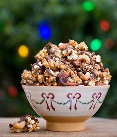 Reindeer Crunch:12 C plain popped popcorn, 1 1/2 C salted mixed nuts, 1/2 C butter, 2 C packed brown sugar, 1/4 C light corn syrup, 1/4 tsp salt, 1 tsp vanilla, 12 oz choc chips. Melt butter in saucepan. Stir in brown sugar, corn syrup and salt and bring to a boil over medium heat, stirring constantly. Boil 5 mins, stirring now and then. Stir in vanilla. Pour over popcorn + nuts. Bake on greased sheet @ 250 for 30 mins. Stir once. Cool & break into chunks. Melt choc chips & drizzle over popcorn.