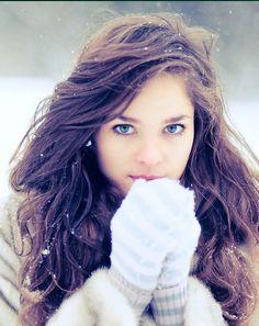Light ash brown hair, big messy waves, blue eyes. Perfect.