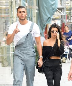 Besotted: Kourtney Kardashian and Younes Bendjima still looked in the first throes of love...