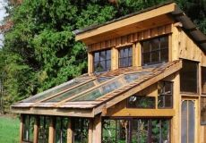 Green house made from reclaimed wood planks (deck & old cedar siding) & old windows from a house. This would be a great project for someone who renovating a house! PS: Cedar naturally lasts longer in the elements!