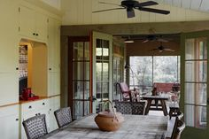 Dining room opening to screen porch. The ceiling fans are so practical. Rustic barn inspired vacation retreat on Spring Island