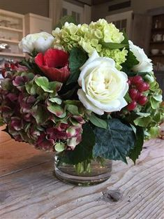 Non traditional holiday bouquet. Red tinged hydrangeas, white roses, ranunculus, red anemones, plus lots of lime green hydrangeas and leaves to set them off - with red hypericum berries for a hit of deep red! Christmas Flower Arrangements, Christmas Flowers, Christmas Centerpieces, Floral Centerpieces, Floral Arrangements, Tall Centerpiece, Centerpiece Wedding, Winter Flowers, Garden Types