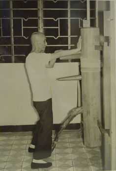Wing Chun Grandmaster Ip Man practicing on a wooden dummy in 1967.4