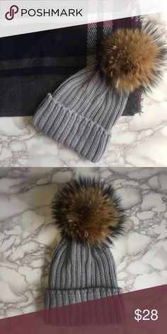 ✨NEW✨ Beanie With Raccoon Pom Pom Grey acrylic beanie hat with raccoon fur pom pom at the top. Pair it with a matching scarf for a great gift option!! Five star rated boutique item!! Chic Boutique Accessories Hats