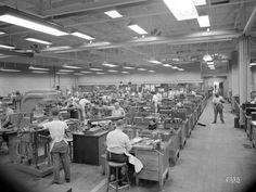 Men working in a machine shop in the 1940s.