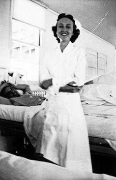 Army nurse Rachel Brower Twiddy stands at the bedside of a patient while at work on a hospital ward at Fort Ord, California, in 1942 ~