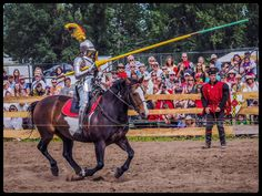 Frederic Piraux (in red) watches Stacy Wasson joust against her opponent at  Brooks Medieval Faire Jousting Tournament 2014 (photo by Grant Zelych)