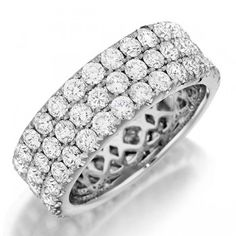 Henri Daussi R18 Wedding Ring Henri Daussi shared prong diamond wedding band. This gorgeous wedding ring features multiple rows of hand-matched diamonds. Band is available with diamonds either halfway around or all the way around.