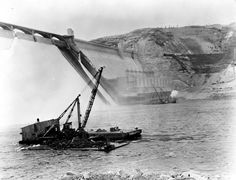 January 27, 1947. Excavating river bottom prior to setting up caison for spillway bucket repairs at Grand Coulee Dam.
