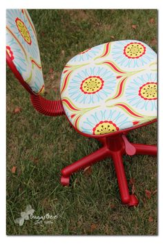 I will never pass up an old office chair on the corner again if this is what you can turn them into!  Great choice of fabric too.