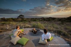 Saturday evening sundowners...fireside at Tortilis Camp. We wouldn't be anywhere else in the world  Image credit: Silverless