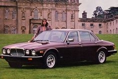 Production photo of the 1983 Jaguar XJ6. Six cylinder, wood-paneled dashboard, leather seats, and that iconic sloped nose. Gorgeous!