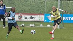 Thulani Serero and Nicolai Boilesen on the Ajax training today, in the background Mickey van het Hart.