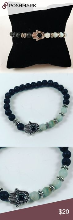 Women Hamsa beaded bracelet lava rock Women beaded bracelet . Fits most 5.5 to 7 inch wrist. Handmade by me , never worn by anyone. Made with black lava rocks / volcano beads. Amazonite beads . Tibetan silver Hamsa / hand of god / Fatima's hand charm . I ship fast!!✈️ Bundle and save! ( 10 % off bundles) REASONABLE offers considered. Any questions let me know! NO PAYPAL ! Jewelry Bracelets