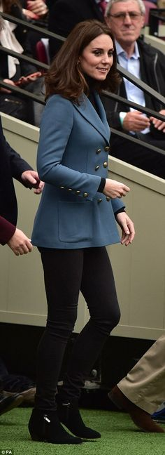 The Duchess of Cambridge walks on to the pitch at West Ham's London Stadium, the former Olympic Park