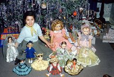 Young Girl with all her doll in front of Christmas 1948