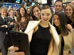 Snapchat Filters – Supermodel Miranda Kerr (and fiancé to Snapchat CEO, Evan Spiegel) taking a selfie with friends at the NYSE opening bell as Snap Inc. celebrates its IPO