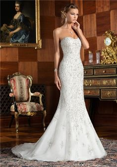 Strapless beaded fit and flare with subtle sweetheart neckline; low cut out back