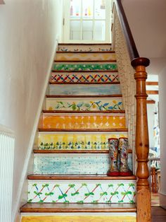 Use stamps, stencils or freeform designs, but to keep it looking eclectic, not crazy, stick to just a few colors (like the blue, green, orange and yellow here). The watercolor effect on these stairs, with visible brushstrokes, is achieved by thinning your paint with a latex extender