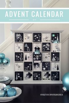 Wooden Advent Calendar painted black and white and decorated with silver numbers, black and white bows, and black, white and silver embellishments.