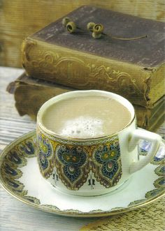 Cup and books by anniehallx, via Flickr