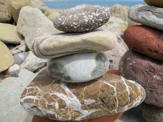 Creating rock sculptures on at the beach.