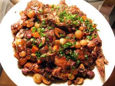 Coq-au-vin is truly a great winter recipe for entertaining or for a special family meal. Made the day before all the wine and seasonings are well blended for superb  taste
