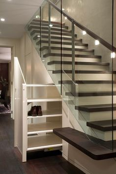 House in West London contemporary staircase; storage under the stairs