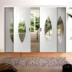 A free delivery is standard, these Easi-Slide White Pesaro style sliding doors incorporating a frame and track set with fixed side insets includes clear safety glass, all would be supplied without decoration. #internalglazedslidingdoors #interiordoordesignideas #whiteglazedslidingdoors