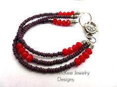 red crystals, purple seed beads, silver heart clasp bracelet. McKee Jewelry Designs