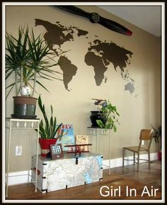 I have a thing for maps...love the painted wall map and really LOVE the map-coupaged trunk!