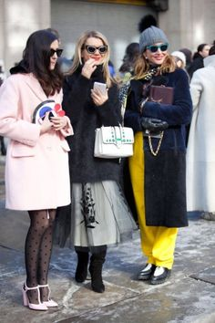 CAN WE TALK ABOUT THESE LADIES?! The polka dots with pastels, the princess grunge, and the neon. Fabulous. - - - NYC Street Style 2014 elle