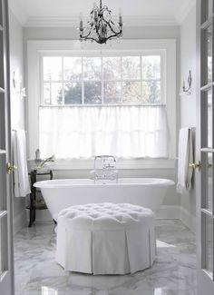 bathrooms - platinum gray walls white twill round tufted storage ottoman freestanding tub marble tiles floor bronze crystal chandelier Elegant