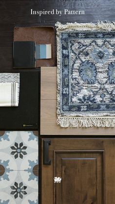 A mix of artisan fabrics, prints, and tiles in the same color family allow you to bring a warm, worldly flair to your space in a design-minded fashion. This palette features distinctly captivating patterns in rich shades of indigo, chestnut, ivory, blue-gray, and black. [Featured Design: Cambria Black™]
