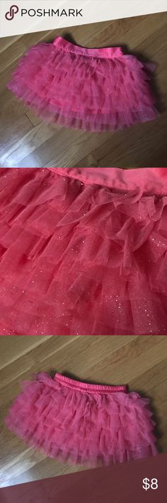 🔶 Pink Sparkle Ruffle Tutu 🔶 Beautiful and poofy pink tutu with silver sparkles. Perfect for dance class, dress up, or every day wear. New condition. Size 2T. 🔶 Bundle any 3 yellow diamond (🔶) items for $15. Simply use the bundle offer feature or ask me to create a special listing for you. Bottoms Skirts