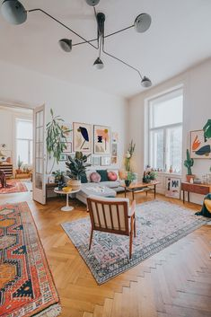 Abstract art of Jan Skacelik is a major focal point in this mid-century boho living room interior #abstractart #livingroom #interiordesign