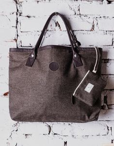Booth Wool Bag. The generous landscape format provides plenty of storage space and it also features inside pocket with button.