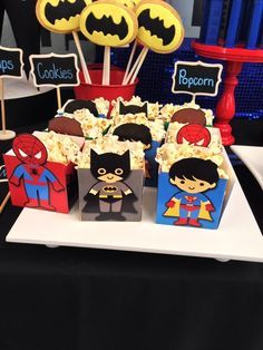 Cute popcorn containers at a  Superhero Party!  See more party ideas at http://CatchMyParty.com!  /search/?q=%23partyideas&rs=hashtag /search/?q=%23superhero&rs=hashtag