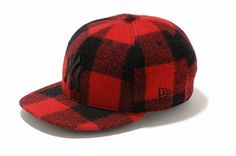 """Had the red and black lumberjack / With the hat to match."" By New Era Japan and Woolrich."