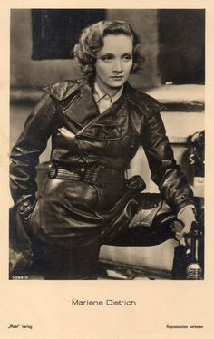 Marlene in Leather holding Luger