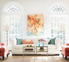 Coral & Turquoise: The colors of summer! These two colors contrast beautifully on a white sofa.