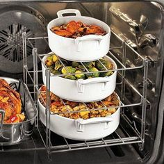 Multi-Tier Oven Rack from Sur la Table .perfect for dinner parties Who doen't need this? - if next oven doesn't have two racks and dishes fit side by side. My current oven fits four dishes just fine. Kitchen Hacks, Kitchen Gadgets, Kitchen Tools, Kitchen Utensils, Kitchen Products, Kitchen Things, Kitchen Items, Kitchen Stuff, Cocina Office