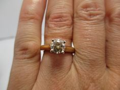 $1395.00 1.05 ct, SI2, C-2 (champagne) diamond set in 14Kt yellow gold engagment ring
